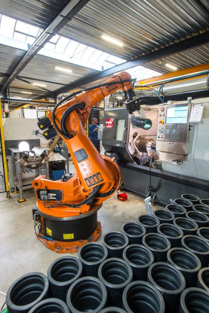 ligne de production de pièces plastiques automatisée